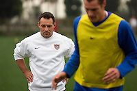 USMNT Assistant Coach Peter Nowak watches Nate Jaqua during a training session.