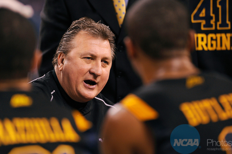 3 APR 2010: West Virginia head coach Bob Huggins talks with his players during the semi final game between Duke and West Virginia at the Men's Final Four Basketball Championships held at Lucas Oil Stadium in Indianapolis, IN. Duke defeated West Virginia 78-57 to advance to the national championship. Ryan McKee/NCAA Photos