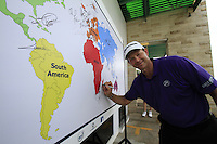 Retief Goosen (RSA) signs the world map after finishing his round during Sunday's Final Round of the rain shortened 2011 Barclays Singapore Open, Singapore, 13th November 2011 (Photo Eoin Clarke/www.golffile.ie)
