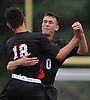 Ethan Koval #18 of Half Hollow Hills East, left, gets congratulated by teammate Jacob Chizner #20 after scoring a goal in the fourth minute of a Suffolk County League II varsity boys soccer game against host Whitman High School on Monday, Sept. 19, 2016. Hills East went on to win by a score of 2-1.