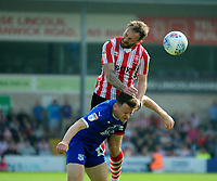 Lincoln City's Neal Eardley gets above Tranmere Rovers' Connor Jennings<br /> <br /> Photographer Andrew Vaughan/CameraSport<br /> <br /> The EFL Sky Bet League Two - Lincoln City v Tranmere Rovers - Monday 22nd April 2019 - Sincil Bank - Lincoln<br /> <br /> World Copyright © 2019 CameraSport. All rights reserved. 43 Linden Ave. Countesthorpe. Leicester. England. LE8 5PG - Tel: +44 (0) 116 277 4147 - admin@camerasport.com - www.camerasport.com