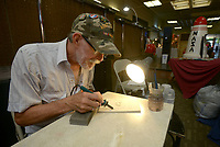 NWA Democrat-Gazette/BEN GOFF @NWABENGOFF<br /> Albert Johnson of Rogers works on a wood burning piece Sunday, May 7, 2017, at his table during the spring Frisco Station Mall Arts and Crafts Festival in Rogers.