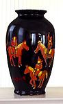 """Mongolian Riders""<br /> <br /> High gloss enamel paints on black ceramic pot.<br /> 14"" x 8""<br /> <br /> $2,900."