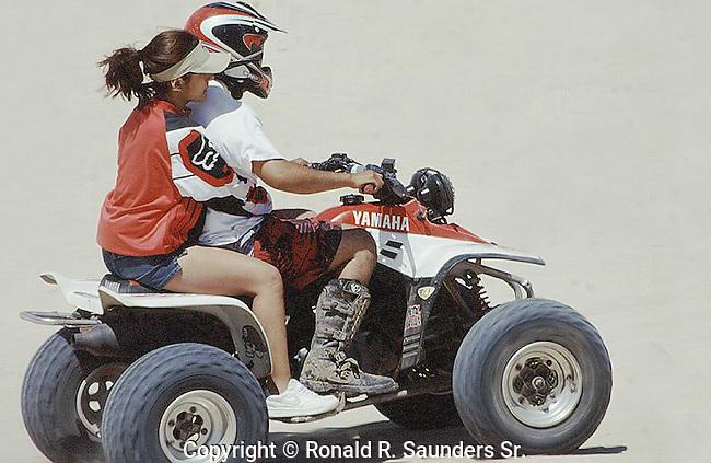 COUPLE HAVING FUN ON ATV IN MEXICO