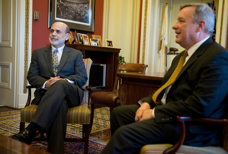 Ben Bernanke, Chairman of the Federal Reserve, left, and House Majority Whip Richard Durbin, D-Ill., sit down for a meeting in the Capitol, Jan. 25, 2010.