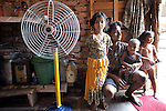 Twenty eight  year old Birender Singh from Uttar Pradesh, with his kids (left to right)  Sandhya, Alok and Ruchika inside his home which is built into part of an ancient Lodhi period tomb complex at Nizamuddin in Delhi, India. The Archaeological Survey of India has been on a campaign to evict people who have illegally made the tombs their homes throughout the city in recent times but is facing stiff opposition from the residents who have settled in.