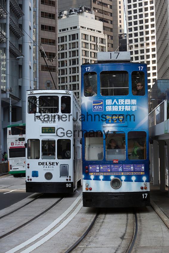 People's Republic of China, Hong Kong: Double decked tramcars along Bank Street | Volksrepublik China, Hongkong: Doppeldecker-Strassenbahnen in der Bank Street