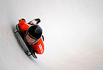14 December 2007: Katie Uhlaender, racing for the USA, exits the last turn and heads for the finish line during her first run of the FIBT World Cup Skeleton Competition at the Olympic Sports Complex on Mount Van Hoevenberg, at Lake Placid, New York, USA. ..Mandatory Photo Credit: Ed Wolfstein Photo
