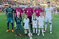 Child mascots with referee Michael Oliver, Southampton captain Ryan Bertrand (L) and Federico Fernandez (R) during the Premier League match between Swansea City and Southampton at The Liberty Stadium, Swansea, Wales, UK. Tuesday 08 May 2018