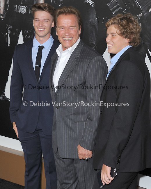 Arnold Scwarzenegger and sons at Lionsgate World Premiere of The Expendables 2 held at The Grauman's Chinese Theatre in Hollywood, California on August 15,2012                                                                               © 2012 Hollywood Press Agency