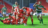 Scarlets' Gareth Davies clears his lines while under pressure from Benetton Treviso's Dean Budd.<br /> <br /> Photographer Dan Minto/CameraSport<br /> <br /> Guinness PRO12 Round 19 - Scarlets v Benetton Treviso - Saturday 8th April 2017 - Parc y Scarlets - Llanelli, Wales<br /> <br /> World Copyright &copy; 2017 CameraSport. All rights reserved. 43 Linden Ave. Countesthorpe. Leicester. England. LE8 5PG - Tel: +44 (0) 116 277 4147 - admin@camerasport.com - www.camerasport.com