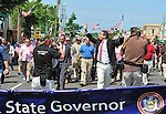 MAY 30, 2011 - Little Neck, New York, U.S. - New York Governor ANDREW CUOMO (Democrat) waves to crowds as he marches in Little Neck-Douglaston Memorial Day Parade, which honors America's veterans, on Northern Boulevard. A big blue banner with 'New York State Governor Andrew M. Cuomo' written on it is at front of Governor and group marching with him.