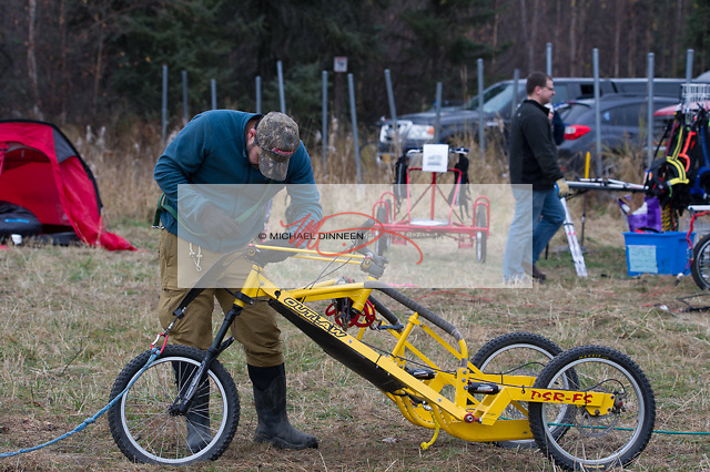 A three-wheeler dog cart is worked on whale a four-wheeler awaits a buyer in the background.  Photo fo the Star by Michael Dinneen