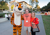 Doug Raff '81 and Mitzi (Raff) Poetzinger '86 pose with Oswald. Occidental College students, their families and alumni enjoy the Tiger Tailgate & Oswald's Carnival in the Academic Quad during Homecoming, Oct. 25, 2014. (Photo by Marc Campos, Occidental College Photographer)
