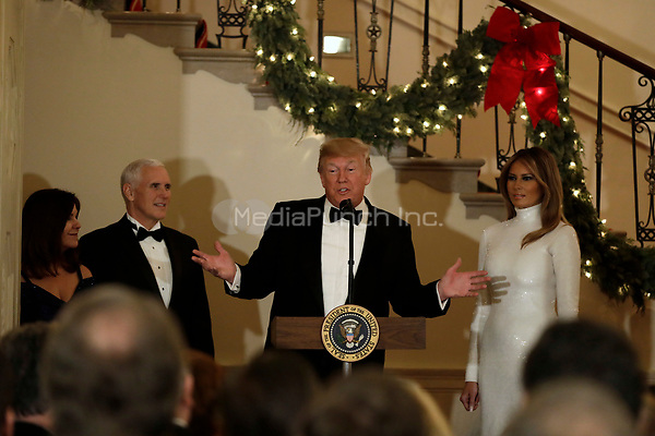 United States President Donald J. Trump makes remarks as First lady Melania Trump, US Vice President Mike Pence, and Karen Pence look on at the Congressional Ball at White House in Washington, DC on December 15, 2018. <br /> Credit: Yuri Gripas / Pool via CNP / MediaPunch