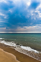 Rain clouds over lake Michigan at Warren Dunes State Park in Michigan. It ended up not raining, they drifted by.