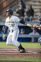 Michigan Wolverines designated hitter Jordan Nwogu (42) follows through on his swing against the San Jose State Spartans on March 27, 2019 in Game 2 of the NCAA baseball doubleheader at Ray Fisher Stadium in Ann Arbor, Michigan. Michigan defeated San Jose State 3-0. (Andrew Woolley/Four Seam Images)