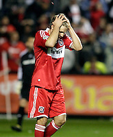 Chicago Fire midfielder Logan Pause (7) reacts after failing to convert his penalty kick.  Real Salt Lake defeated the Chicago Fire in a penalty kick shootout 0-0 (5-4 PK) in the Eastern Conference Final at Toyota Park in Bridgeview, IL on November 14, 2009.