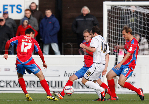 27.10.2012 Dagenham, England: ..Left to Right Luke Howell of Dagenham & Redbridge,Danny Hylton of Aldershot Town ,Scott Doe and Luke Wilkinson of Dagenham & Redbridge..in action during the League Two match between Dagenham and Redbridge & Aldershot Town from The L.B Barking & Dag Stadium, Victoria Road..