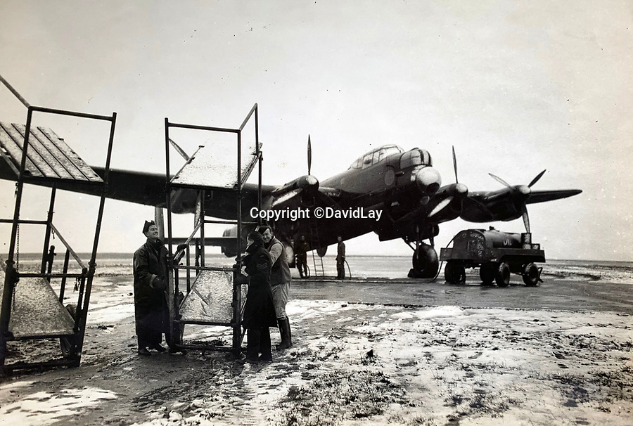 BNPS.co.uk (01202 558833)<br /> Pic:  DavidLay/BNPS<br /> <br /> Lancaster being prepared for a raid in the snow.<br /> <br /> Bomber command heroes WW2 exploits discovered in a shoebox.<br /> <br /> The personal effects of a fearless 'Tail-end Charlie' have been discovered in a shoebox - and they include a charming set of photos of his wartime service.<br /> <br /> Flight Sergeant Douglas Alexander, of 460 Squadron, took part in nearly 40 bombing raids over Germany, including the famous assault on Hitler's mountain retreat, Berchtesgaden.<br /> <br /> As a tail gunner, he sat in a tiny glass turret at the rear of Lancaster and Halifax bombers - a terribly exposed position.<br /> <br /> The shoebox, containing his bravery medals, logbooks and photos, was bought into auctioneer David Lay Frics, of Penzance, Cornwall, by his daughter.<br /> <br /> Flt Sgt Alexander's medal group includes the prestigious Distinguished Flying Medal, awarded for 'exceptional valour, courage and devotion to duty', with his photos capturing the camarederie which existed in the RAF as the airmen risked their lives on every mission to defeat Adolf Hitler.