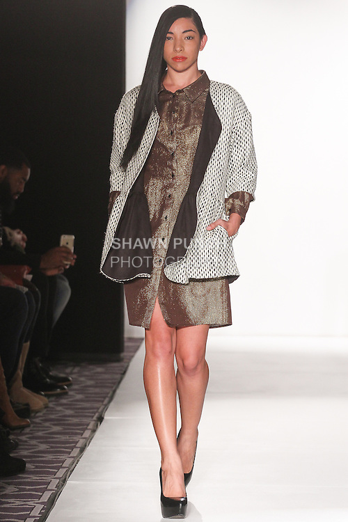 Model walks runway in an outfit from LM by Leanne Marshall Fall 2015 collection, during Fashion Gallery New York Fashion Week Fall 2015.
