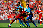 Liverpool's Georginio Wijnaldum (C) in action with Arsenal's Danny Welbeck (L) and Hector Bellerin during the premier league match at Anfield Stadium, Liverpool. Picture date 27th August 2017. Picture credit should read: Paul Thomas/Sportimage