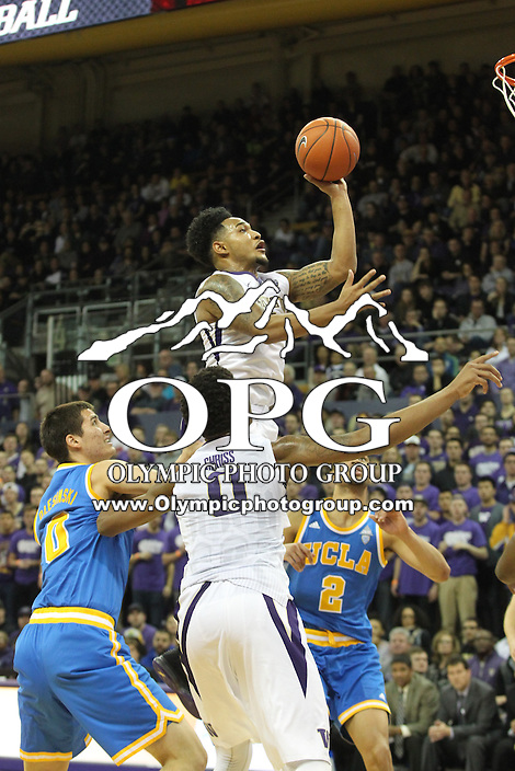 JAN 1, 2016:  Washington's #1 David Crisp goes up in the air for a layup against UCLA.  Washington defeated #25 ranked UCLA 96-93 in double overtime at Alaska Airlines Arena in Seattle, WA.