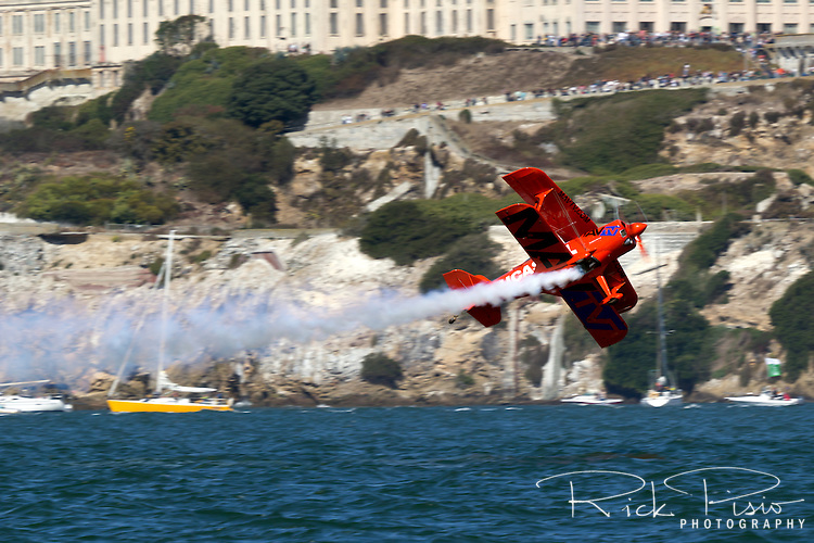 Michael Wiskus pilots the Lucas Oil Air Shows Pitts S1-11B biplane low over the waters of San Francisco Bay