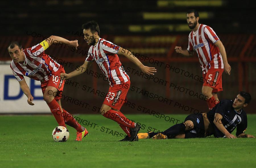 Fudbal Jelen super league season 2013-2014<br /> Crvena Zvezda v Rad <br /> Milos Ninkovic (C) Nenad Milijas (L) and Nikola Mijailovic<br /> Beograd, 05.03.2014.<br /> foto: Srdjan Stevanovic/Starsportphoto&copy;