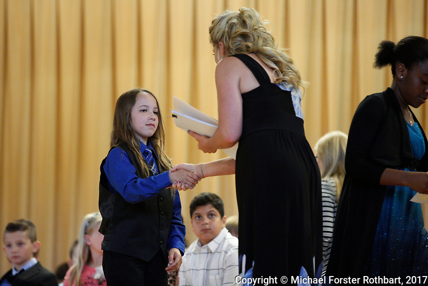 The Oneonta Greater Plains elementary school fifth grade awards ceremony, on June 21, 2017.<br /> &copy; Michael Forster Rothbart Photography<br /> www.mfrphoto.org &bull; 607-267-4893<br /> 34 Spruce St, Oneonta, NY 13820<br /> 86 Three Mile Pond Rd, Vassalboro, ME 04989<br /> info@mfrphoto.org<br /> Photo by: Michael Forster Rothbart<br /> Date:  6/21/2017<br /> File#:  Canon &mdash; Canon EOS 5D Mark III digital camera frame C19141