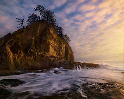 A slightly longer shutter speed captures the water receding into the ocean after big wave action at sunset on the Olympic coast.<br />