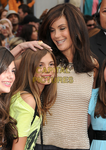 """EMERSON ROSE TENNEY & TERI HATCHER.""""The Hannah Montana Movie"""" Los Angeles Premiere held at the El Capitan Theatre, Hollywood, California, USA. .April 2nd, 2009.half length beige gold beaded beads daughter family mother mom mum hand on head silver silver                                              .CAP/DVS.©Debbie VanStory/Capital Pictures."""