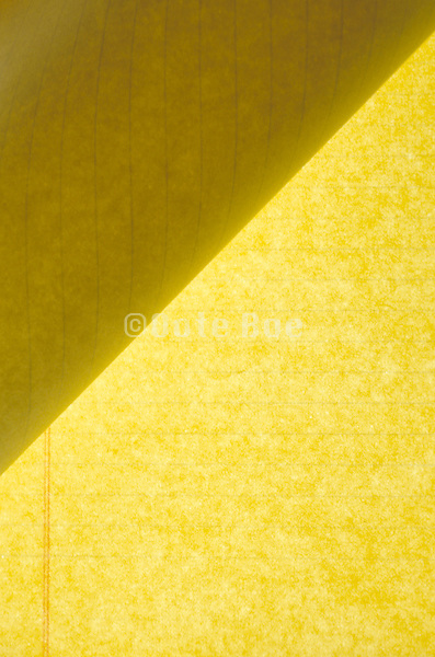 folded over page of yellow legal pad