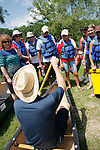 Instructor teaches students on canoe paddle technique and style.