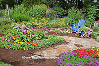63821-21820 Flower garden with blue Adirondack chair and blue bird house. Butterfly Bushes, Peach & Purple Verbenas, Yellow Lantana (Lantana camara), Karl Forster Grass, Black-eyed Susans (Rudbeckia hirta), Homestead Purple Verbena (Verbena canadensis), Red Verbena, New Gold Lantana (Lantana camara)  Marion Co., IL