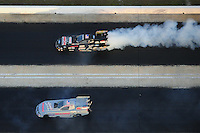 Jan. 21, 2012; Jupiter, FL, USA: Aerial view of NHRA funny car driver John Force (top) doing a burnout alongside daughter Courtney Force during testing at the PRO Winter Warmup at Palm Beach International Raceway. Mandatory Credit: Mark J. Rebilas-