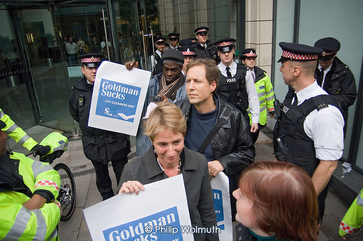 Protesters leave the Fleet Street offices of Goldman Sachs after occupying the building to demand union recognition for cleaners campaigning for imporved pay and conditions.