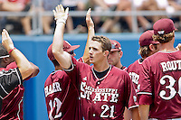 June 12, 2011:    Mississippi State Bulldogs inf/of Nick Vickerson (21) celebrates with team mates after hitting a home run during NCAA Gainesville Super Regional Game 3 action between Florida Gators and Mississippi State Bulldogs played at Alfred A. McKethan Stadium on the campus of Florida University in Gainesville, Florida.  Florida defeated Mississippi State 8-6 to advance to the College World Series in Omaha, Nebraska........