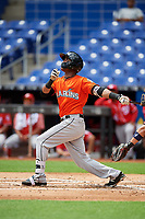 Miami Marlins Marcos Rivera (17) follows through on a swing during a Florida Instructional League game against the Washington Nationals on September 26, 2018 at the Marlins Park in Miami, Florida.  (Mike Janes/Four Seam Images)