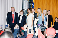 Surrounded by family President-elect Donald Trump enters the ballroom in the Midtown Hilton at the election night victory rally for Republican presidential nominee Donald Trump, after the presidential race was called for Trump in the early hours of Nov. 9, 2016.