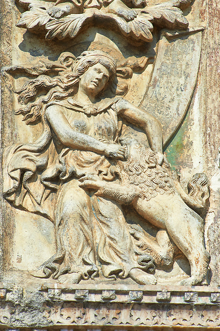13th century Medieval Romanesque Sculptures from the above the central door of the facade of St Mark's Basilica, Venice, depicting fortitude from the theme Virtues and Beatitudes .