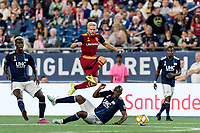 FOXBOROUGH, MA - SEPTEMBER 21: Kelyn Rowe #6 of Real Salt Lake on the attack hurdles Juan Fernando Caicedo #9 of New England Revolution during a game between Real Salt Lake and New England Revolution at Gillette Stadium on September 21, 2019 in Foxborough, Massachusetts.