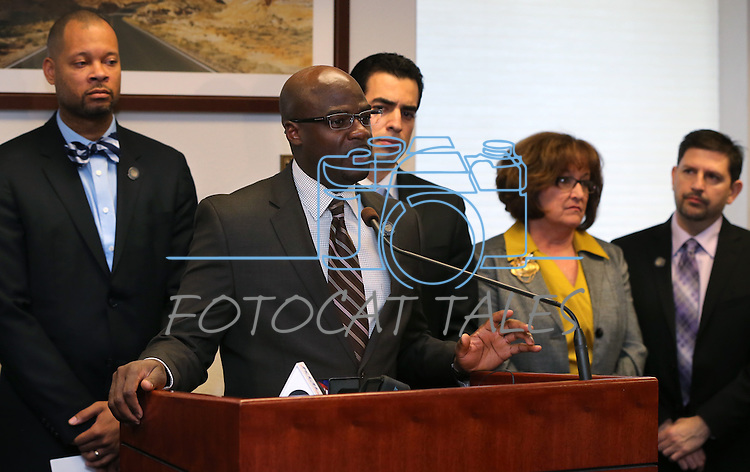 Surrounded by Nevada Senate Democrats, Sen. Kelvin Atkinson, D-North Las Vegas, speaks at a press conference on Tuesday, Feb. 19, 2013, at the Legislative Building in Carson City, Nev. From left, rear are Senators Aaron Ford, Ruben Kihuen, Debbie Smith and Mark Manendo..Photo by Cathleen Allison