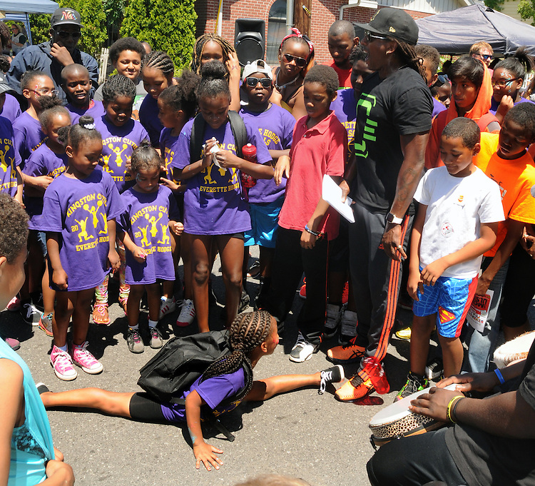 Young People in the audience are challenged to demonstrate their dance moves to music of the Percussion Orchestra of Kingston (POOK) at the 11th Annual Mid-town Make a Difference Day Celebration on Franklin Street, in Kingston, NY on Saturday, June  18, 2016. Photo by Jim Peppler. Copyright Jim Peppler 2016.