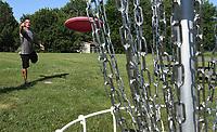 NWA Democrat-Gazette/J.T. WAMPLER  Ryan Dolby of Rogers makes a putt Tuesday June 5, 2018 at J. Beast Disc Golf Course at J.B. Hunt Park in Springdale.