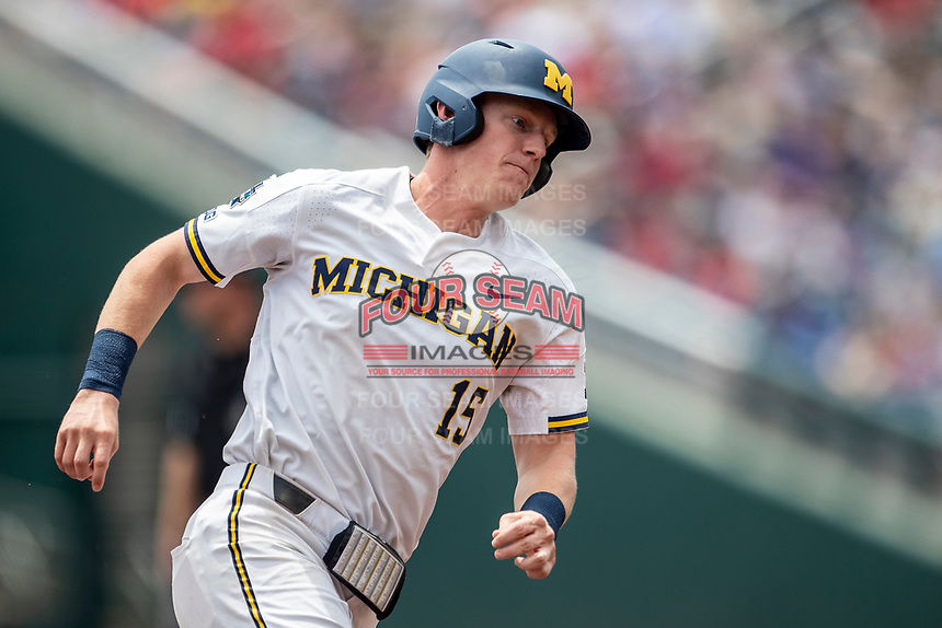 Michigan Wolverines first baseman Jimmy Kerr (15) rounds third base headed home against the Texas Tech Red Raiders in the NCAA College World Series on June 21, 2019 at TD Ameritrade Park in Omaha, Nebraska. Michigan defeated Texas Tech 15-3 and will play in the CWS Finals. (Andrew Woolley/Four Seam Images)