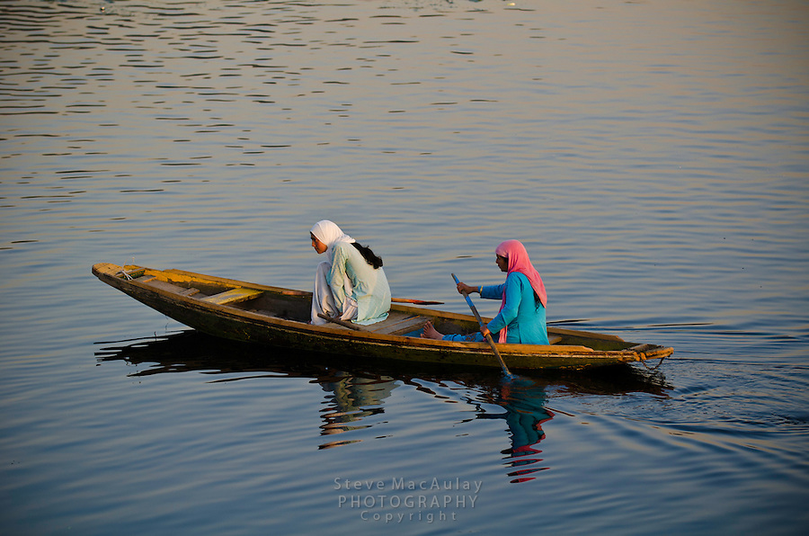 Muslim women on a Shikara, or gondola boat, on Dal Lake, Srinagar, Kashmir, India.