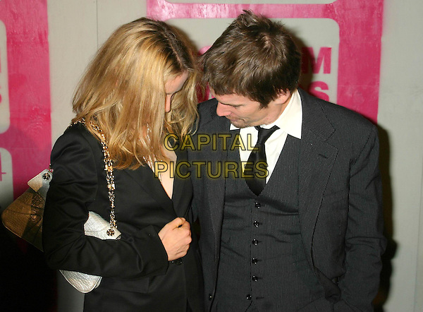 JULIE DELPY & ETHAN HAWKE.The 14th Annual Gotham Awards, Pier 60, Chelsea Piers, New York City, New York, USA.01December 2004..half length looking down top jacket.Ref: IW.www.capitalpictures.com.sales@capitalpictures.com.©Capital Pictures.