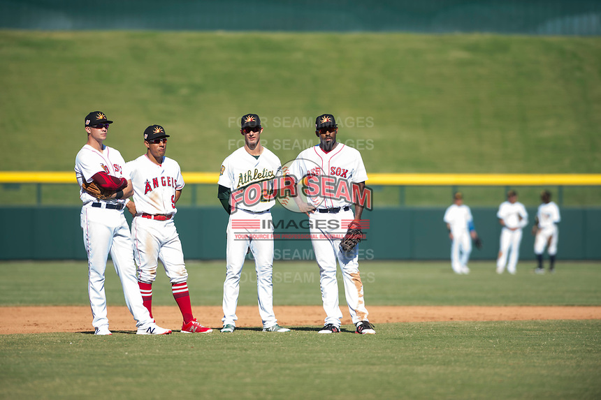 Mesa Solar Sox infielders Bobby Dalbec (11), Jahmai Jones (9), Eli White (21), and Josh Ockimey (28) during an Arizona Fall League game against the Surprise Saguaros at Sloan Park on November 1, 2018 in Mesa, Arizona. Surprise defeated Mesa 5-4 . (Zachary Lucy/Four Seam Images)