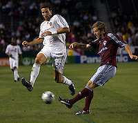 LA Galaxy forward Alan Gordon (21) leaps in front of Colorado Rapids defender Jordan Harvey (2) as he clears the ball. The LA Galaxy defeated the Colorado Rapids 1-0 during the preliminary rounds of the 2008 US Open Cup at Home Depot Center stadium in Carson, Calif., on Tuesday, May 27, 2008.